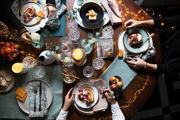 People eating at festively set table