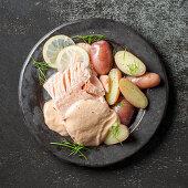 Poached salmon with potatoes and Nantua sauce