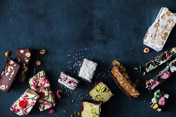 Homemade sweets with chocolate, nuts, dried berries and marshmallows