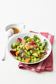 Fava bean salad with red spring onions, pickled salad and broad beans