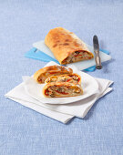 Pizza roll with mackerel, capers, peppers and mozzarella