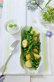 Warm potato salad with green beans and peas