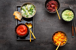 Fondue sides: cranberry sauce, mayonnaise, chutney, ketchup, remoulade