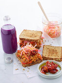 Whole grain sandwich with tahini, chickpeas and marinated vegetables