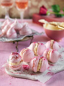 Pink meringues with frosting and raspberry powder for Valentines day