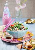 Asian chicken with rice, coriander, chili, nori and peanuts