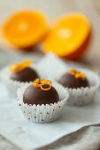 Homemade chocolates with marzipan-orange-nut filling