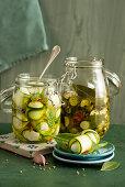 Courgette in vinegar and courgette and mozzarella rolls in oil