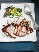 Grilled pork with a blackberry barbecue sauce