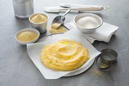 An arrangement of cooked polenta and various types of polenta flour