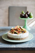 Yoghurt ice cream cake with a walnut and date base, figs and lavender honey
