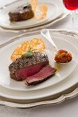 Beef fillet steak with herb-pepper salt and pumpkin chutney