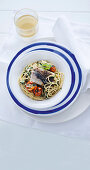 Spaghetti with bass and caramelised cherry tomatoes