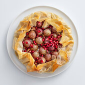 Pink grape cake with Roquefort and pomegranate seeds