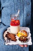 Panaa cotta with orange and blood orange, chocolate fudge with nuts, gingerbread and saffron buns