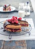 Walnut cake with raspberries and chocolate glaze