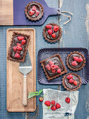 Chocolate tartlets with jasmine ganache and raspberries