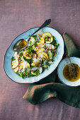 An autumnal wild mushrooms salad with cheese and walnuts