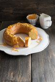 Mascarpone and orange cake with pine nuts