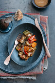 Veal ragout with vegetables and beer