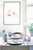 Picture of flowers above set table with spring decorations in pastel shades