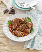 Braised rabbit in a spicy chocolate sauce