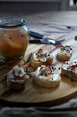 Crostini with cream cheese and apple pickles