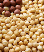 Macadamia nuts with and without shells (filling the picture)