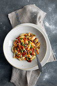 Stockfish gnocchi with olive sauce and pine nuts