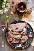 Buckwheat crepes with fruits and jam