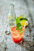 Strawberry Tonic (mocktail with strawberry puree, lime juice and tonic water)