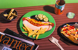 French fries, baked beans and pickles on a plate with a hot dog motif