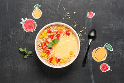 A mango smoothie bowl with strawberries