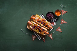 Hot dogs with red onions and ketchup for a Super Bowl party