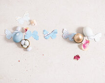 Easter arrangement: paper butterfly, sugar eggs and Easter eggs