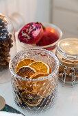 Dried orange slices in glass jar