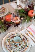Colourful, Oriental-style crockery on festively set table