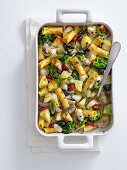 Pasta gratin with potatoes, broccoli, cheese and olives