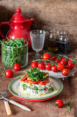 Tomato salad with roast tomatoes. cottage cheese and rocket salad