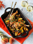 Oven-roasted duck legs with potatoes