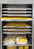 Fresh pasta on a shelf in a commercial kitchen