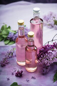 Homemade lilac syrup in bottles