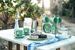 Picnic with yummy dessert and aromatic coffee in garden