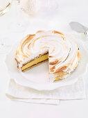 Meringue cake with vanilla cream and berry jam