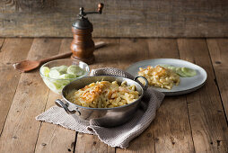 Cheese Spätzle (soft egg noodles from Swabia) with a cucumber salad