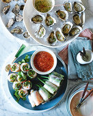 Oysters with ginger vinaigrette and King prawn rice paper rolls