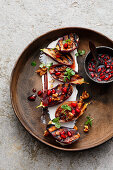 Mini aubergines with goat's cream cheese and pomegranate and honey syrup