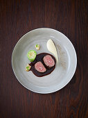 Saddle of venison with pointed cabbage roulade, bacon pears and Jerusalem artichokes