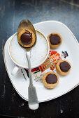 Vegan caramel hazelnut confection and coffee
