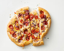 Focaccia with onions and cherry tomatoes
